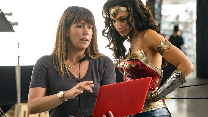 This image released by Warner Bros. Entertainment shows director Patty Jenkins, left, with actress Gal Gadot on the set of Wonder Woman 1984. (Clay Enos/Warner Bros. Entertainment via AP)