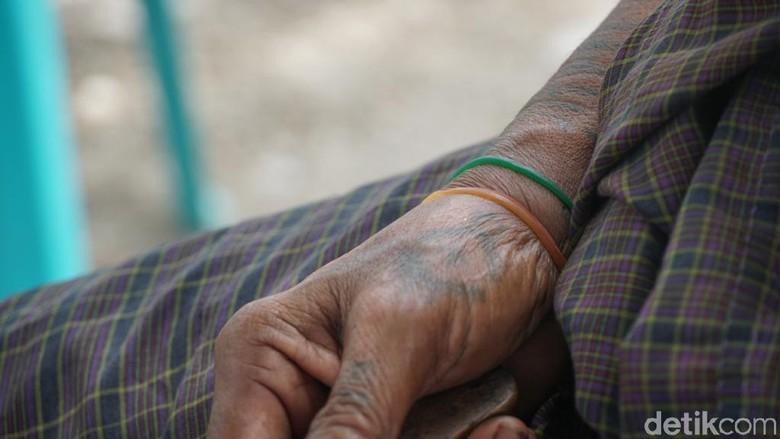 Consertia Nabe (60) dan tato tradisional Malaka