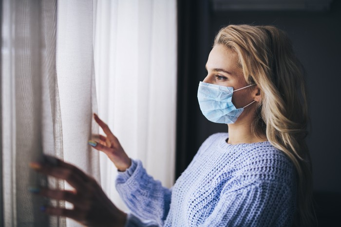 Blonde woman in isolation at home for virus outbreak