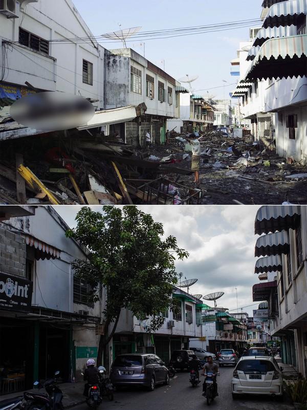 Foto atas menunjukkan betapa dahyatnya dampak tsunami pada 2004 silam. Sementara foto bawah menunjukkan aktivitas warga yang kembali berjalan norman.Ulet Ifansasti/Getty Images.