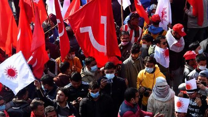 Protesters shout slogans during a demonstration against the dissolution of the countrys parliament in Kathmandu on December 29, 2020. (Photo by PRAKASH MATHEMA / AFP)