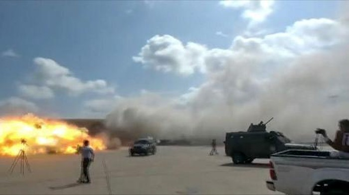 A video grab shows the moment an ordnance hit the airport in the southern Yemeni port city of Aden on December 30, 2020, shortly after the arrival of a plane carrying members of a new unity government. - Explosions rocked Yemens Aden airport on Wednesday shortly after the arrival of a plane carrying members of a new unity government, an AFP correspondent at the scene said.