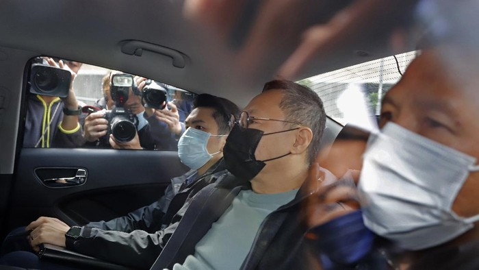 Former law professor Benny Tai, center, a key figure in Hong Kongs 2014 Occupy Central protests and also was one of the main organizers of the primaries, sits in a car after being arrested by police in Hong Kong, Wednesday, Jan. 6, 2021. About 50 Hong Kong pro-democracy figures were arrested by police on Wednesday under a national security law, following their involvement in an unofficial primary election last year held to increase their chances of controlling the legislature, according to local media reports. (AP Photo/Apple Daily)