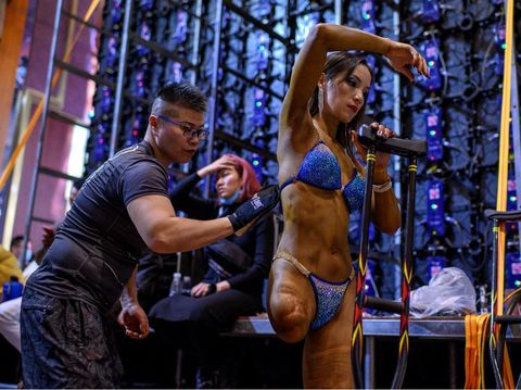 This picture taken on December 11, 2020 shows bodybuilder Gui Yuna on stage during the International Weightlifting Federation (IWF) Beijing 2020 competition in Beijing. - Gui, who competed in long jump at the 2004 Athens Paralympics, is new to bodybuilding but won the first time she competed in October 2020. (Photo by NOEL CELIS / AFP) / TO GO WITH China-sport-disabled-bodybuilding,FOCUS by Peter Stebbbings, and Jessica Yang