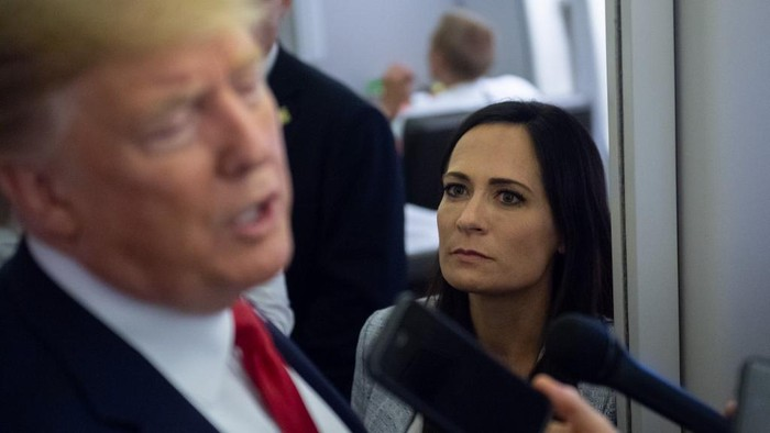 White House Press Secretary Stephanie Grisham listens as US President Donald Trump speaks to the media aboard Air Force One while flying between El Paso, Texas and Joint Base Andrews in Maryland, August 7, 2019. (Photo by SAUL LOEB / AFP)
