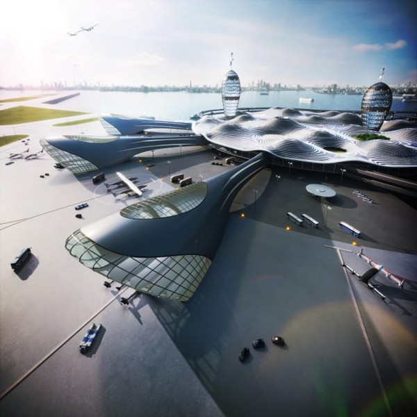 Desain terbaru memperlihatkan bangunan menara baja dan kaca berbentuk silinder menonjol melalui atap panel surya berbentuk bundar. Bangunan ini membentuk Kota Bandara Antariksa atau Spaceport City.