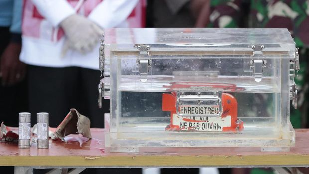 A box containing the flight data recorder recovered from the crash site of the Sriwijaya Air flight SJ-182 in the Java Sea sits on display at Tanjung Priok Port, Tuesday, Jan. 12, 2021. Indonesian navy divers searching the ocean floor on Tuesday recovered the flight data recorder from a Sriwijaya Air jet that crashed into the Java Sea with 62 people on board. (AP Photo/Dita Alangkara)