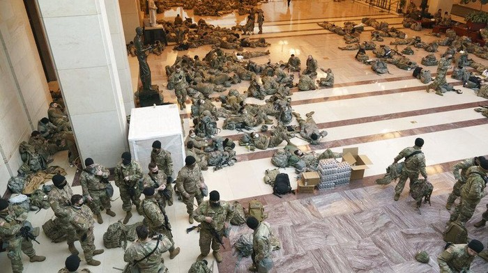 Hundreds of National Guard troops hold inside the Capitol Visitors Center to reinforce security at the Capitol on Wednesday, Jan. 13, 2021, in Washington, D.C.(J. SCOTT APPLEWHITE/AP)