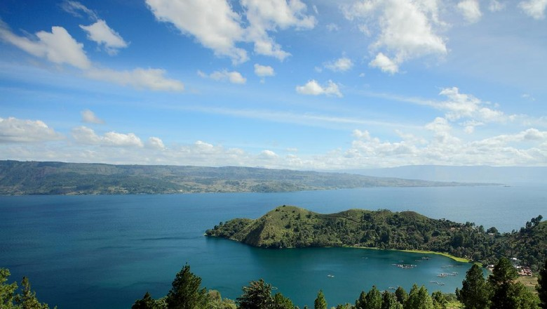 Tanjung Unta in Lake Toba with Samosir Island on the background