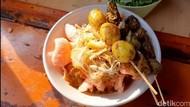Kalori Bubur Ayam Komplet yang Gurih dengan Kuah Kuning Mantap