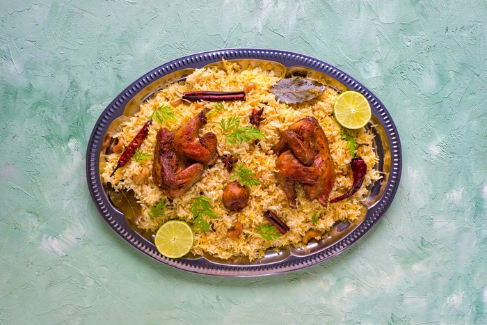 Mandi Kabsa, Yemenis style. Festive dish with baked chicken and rice.