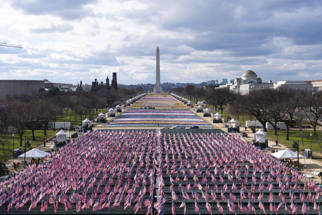 The U.S. Capitol is seen between flags placed on the National Mall ahead of the inauguration of President-elect Joe Biden and Vice President-elect Kamala Harris, Monday, Jan. 18, 2021, in Washington.