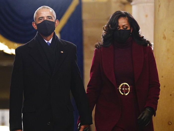 Former President Barack Obama and Michelle Obama arrive at the inauguration of President-elect Joe Biden on the West Front of the U.S. Capitol on Wednesday, Jan 20, 2021 in Washington. (Win McNamee /Pool Photo via AP)