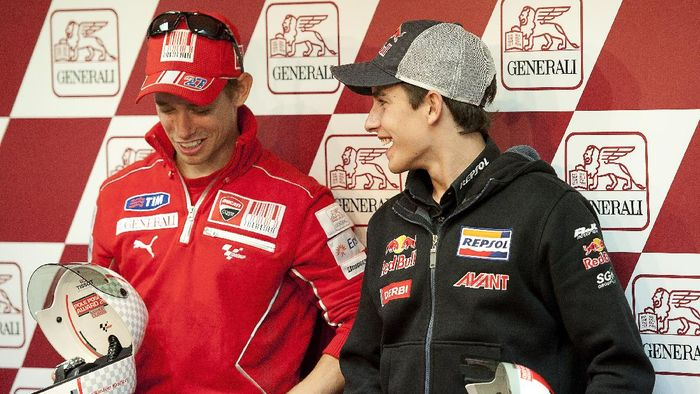 VALENCIA, SPAIN - NOVEMBER 06: Casey Stoner of Australia and Ducati Marlboro Team (L) and  Marc Marquez of Spain and Red Bull AJo Motorsport pose during the press conference after the qualifying practice of MotoGP of Valencia at Ricardo Tormo Circuit on November 6, 2010 in Valencia, Spain.  (Photo by Mirco Lazzari gp/Getty Images)