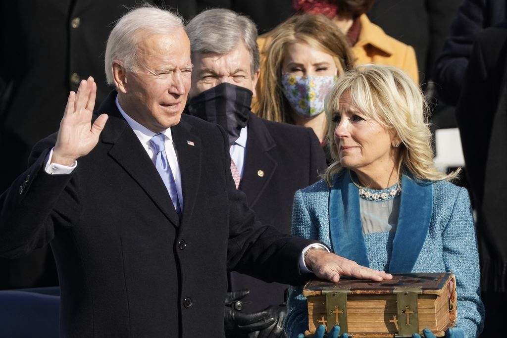 President-elect Joe Biden and his wife Jill Biden arrive at the East Front of the U.S. Capitol ahead of Biden's inauguration, Wednesday, Jan. 20, 2021, at the U.S. Capitol in Washington. ((Jim Lo Scalzo/Pool Photo via AP)