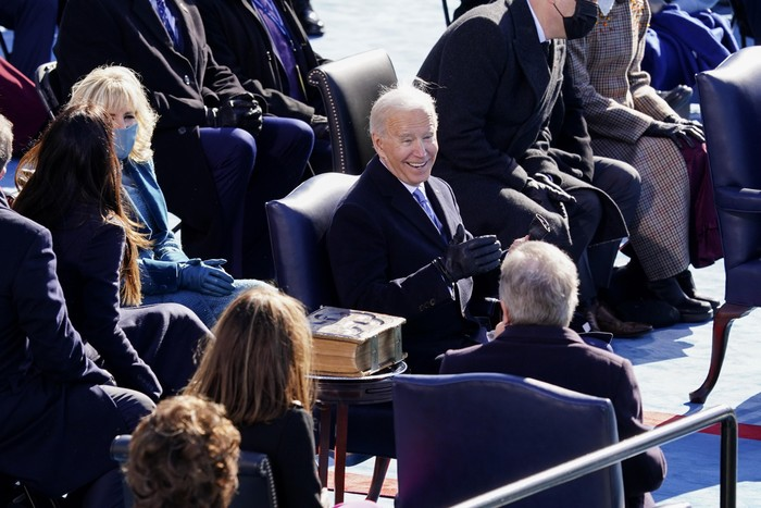 President Joe Biden, center, smiles after speaking at the 59th Presidential Inauguration at the U.S. Capitol in Washington, Wednesday, Jan. 20, 2021. (Kevin Dietsch/Pool Photo via AP)