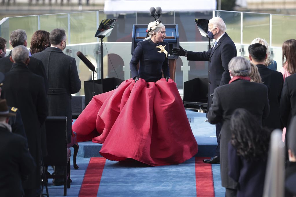 President-elect Joe Biden, center left, and Vice President-elect Kamala Harris, center right, speak to Lady Gaga as she departs after performing the National Anthem during the 59th Presidential Inauguration at the U.S. Capitol in Washington, Wednesday, Jan. 20, 2021. (AP Photo/Andrew Harnik)