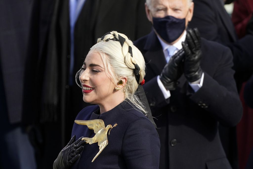 Lady Gaga performs the National Anthem as President-elect Joe Biden applauds during the 59th Presidential Inauguration at the U.S. Capitol in Washington, Wednesday, Jan. 20, 2021. (AP Photo/Andrew Harnik)