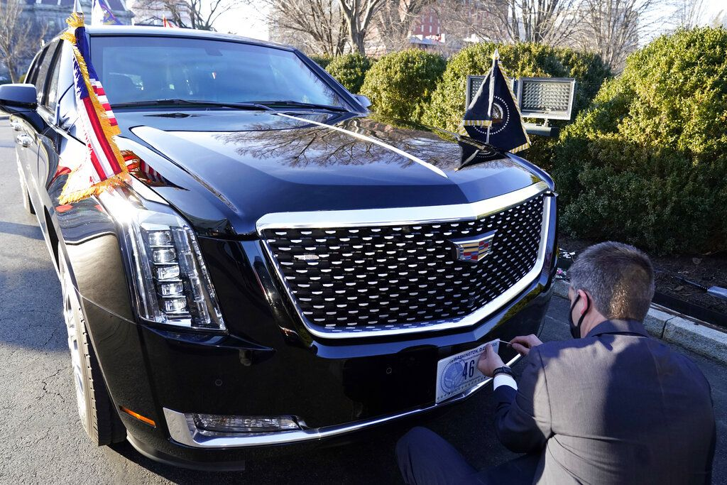 A U.S. Secret Service agent changes the license plate on President Joe Biden's limousine near the North Portico of the White House, Wednesday, Jan. 20, 2021, in Washington. (AP Photo/Alex Brandon, Pool)