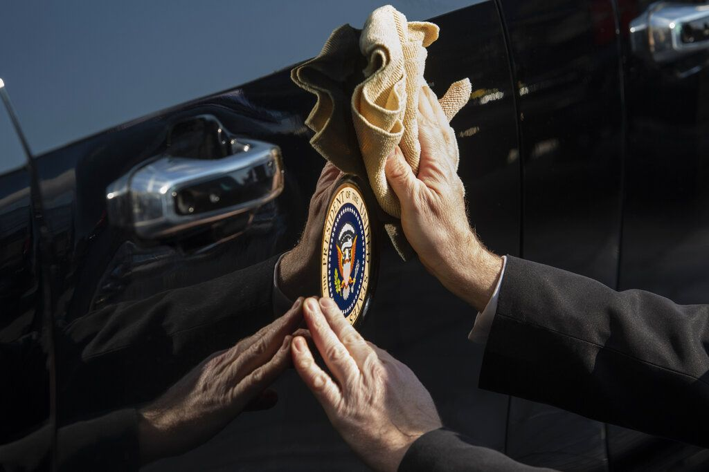 President Joe Biden waves as he rides in the presidential limousine following his inauguration, Wednesday, Jan. 20, 2021, at the U.S. Capitol in Washington.(Rod Lamkey/Pool Photo via AP)
