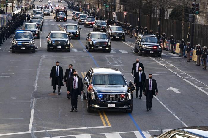 President Joe Biden and first lady Jill Biden, walk near the White House during a Presidential Escort to the White House, Wednesday, Jan. 20, 2021 in Washington. (AP Photo/Jose Luis Magana)
