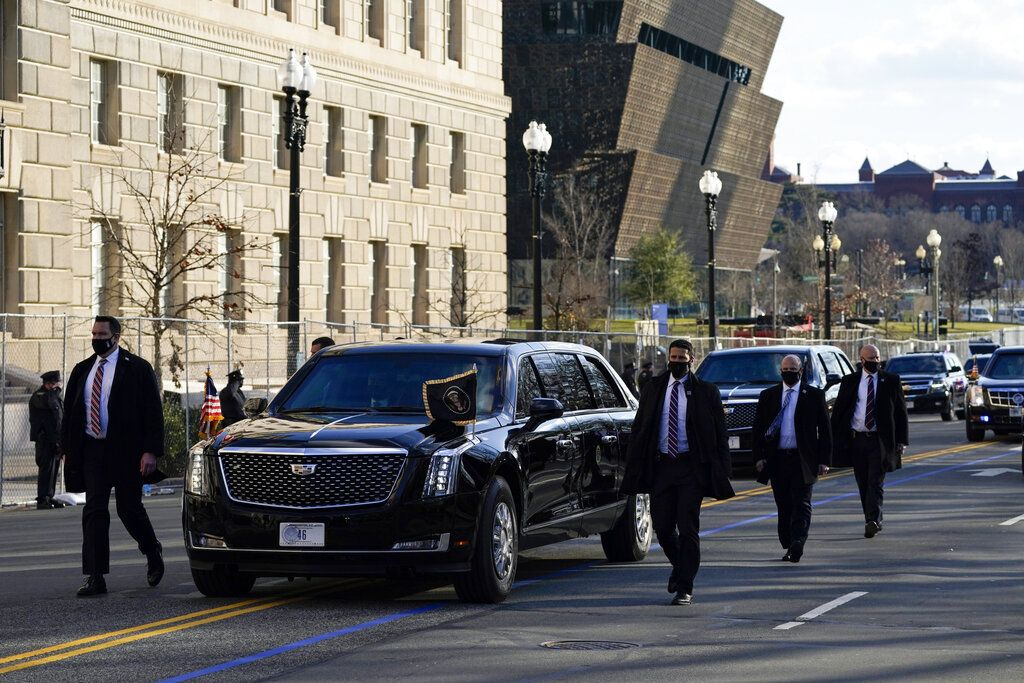 President Joe Biden looks out from the Presidential motorcade during Inauguration Day ceremonies Wednesday, Jan. 20, 2021, in Washington. (AP Photo/Evan Vucci)