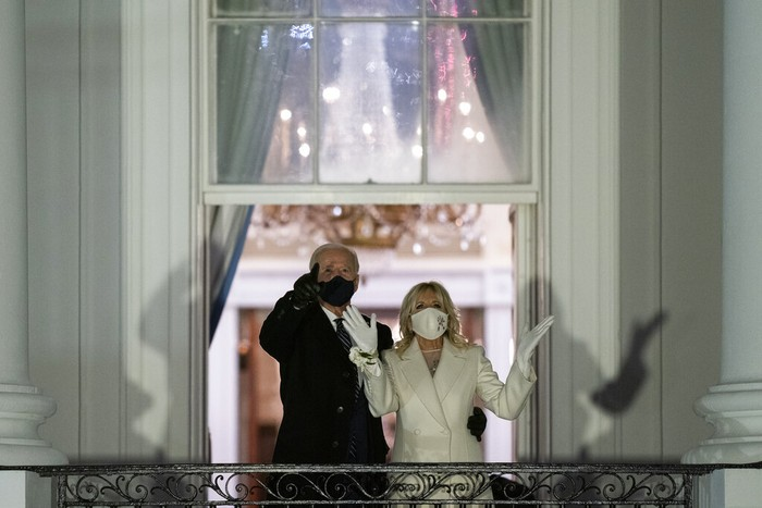 President Joe Biden and first lady Jill Biden watch fireworks from the White House, Wednesday, Jan. 20, 2021, in Washington. (AP Photo/Evan Vucci)