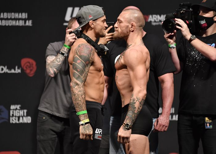 ABU DHABI, UNITED ARAB EMIRATES - JANUARY 22:  In this handout image provided by the UFC, (L-R) Opponents Dustin Poirier and Conor McGregor of Ireland face off during the UFC 257 weigh-in at Etihad Arena on UFC Fight Island on January 22, 2021 in Abu Dhabi, United Arab Emirates. (Photo by Jeff Bottari/Zuffa LLC via Getty Images)