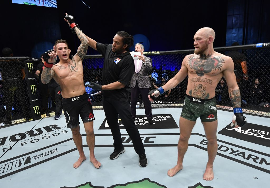 ABU DHABI, UNITED ARAB EMIRATES - JANUARY 23: In this handout image provided by the UFC, Dustin Poirier reacts after his knockout victory over Conor McGregor of Ireland in a lightweight fight during the UFC 257 event inside Etihad Arena on UFC Fight Island on January 23, 2021 in Abu Dhabi, United Arab Emirates. (Photo by Jeff Bottari/Zuffa LLC via Getty Images)