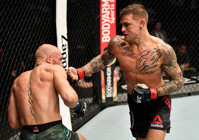 ABU DHABI, UNITED ARAB EMIRATES - JANUARY 23: In this handout image provided by the UFC, (R-L) Dustin Poirier punches Conor McGregor of Ireland in a lightweight fight during the UFC 257 event inside Etihad Arena on UFC Fight Island on January 23, 2021 in Abu Dhabi, United Arab Emirates. (Photo by Jeff Bottari/Zuffa LLC via Getty Images)