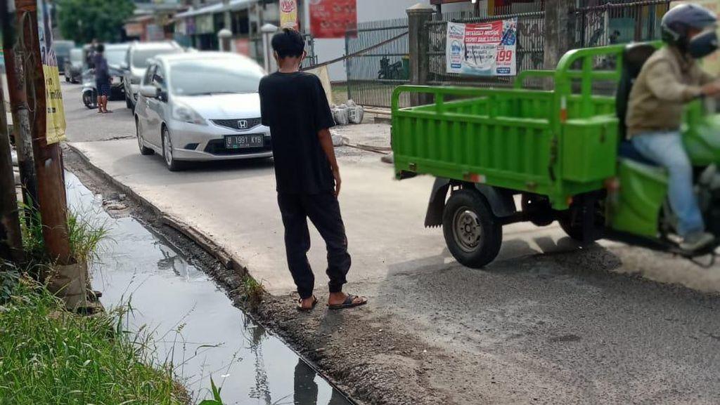 Progres Perbaikan Jl Caman Raya: Kurang 5 Meter Lagi