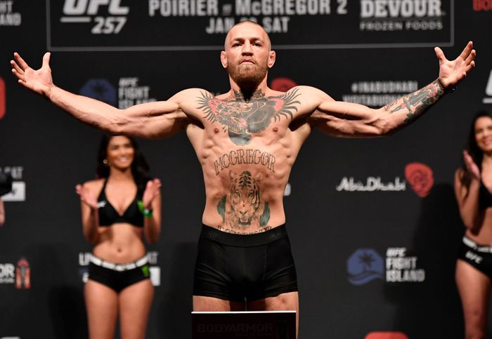 ABU DHABI, UNITED ARAB EMIRATES - JANUARY 22:  In this handout image provided by the UFC, Conor McGregor of Ireland poses on the scale during the UFC 257 weigh-in at Etihad Arena on UFC Fight Island on January 22, 2021 in Abu Dhabi, United Arab Emirates. (Photo by Jeff Bottari/Zuffa LLC via Getty Images)