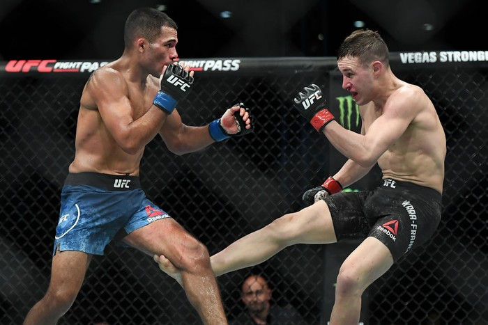 SHENZHEN, CHINA - AUGUST 31:  (R-L) Kai Kara-France of New Zealand kicks Mark De La Rosa in their flyweight bout during the UFC Fight Night event at Shenzhen Universiade Sports Centre on August 31, 2019 in Shenzhen, China.  (Photo by Zhe Ji/Getty Images)