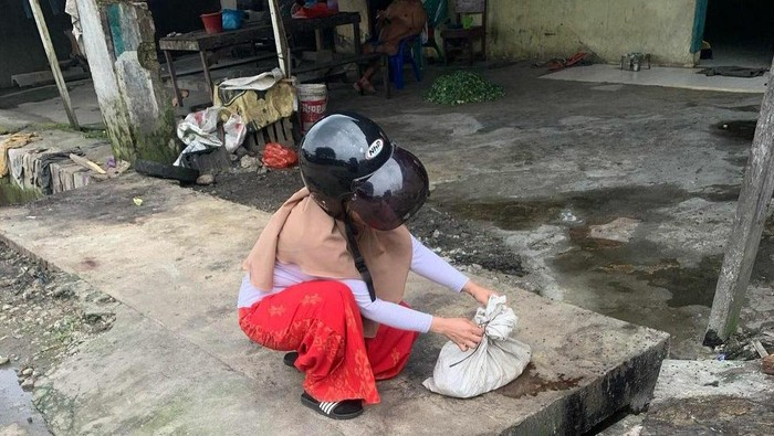 Screenshot posting-an viral wanita temukan goni isi kepala kucing di Medan (dok. Istimewa)