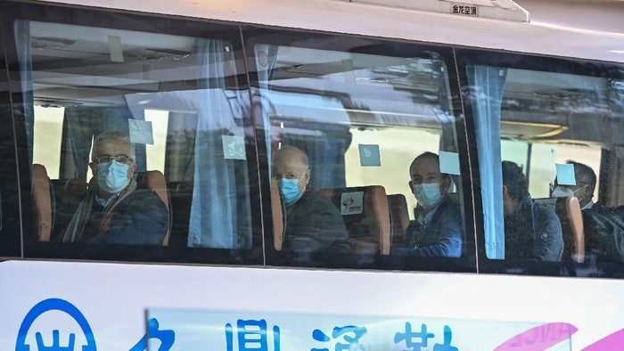 Members of the World Health Organization (WHO) team investigating the origins of the Covid-19 coronavirus pandemic leave The Jade Hotel on a bus after completing their quarantine in Wuhan, Chinas central Hubei province on January 28, 2021. (Photo by Hector RETAMAL / AFP) (Photo by HECTOR RETAMAL/AFP via Getty Images)