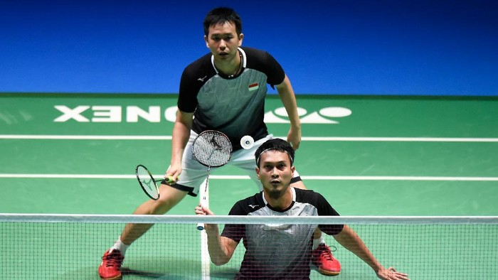 CHOFU, JAPAN - JULY 28: Mohammad Ahsan and Hendra Setiawan of Indonesia compete in the Mens Doubles Final match against Marcus Fernaldi Gideon and Kevin Sanjaya Sukamuljo of Indonesia on day six of the Daihatsu Yonex Japan Open Badminton Championships, Tokyo 2020 Olympic Games test event at Musashino Forest Sport Plaza on July 28, 2019 in Chofu, Tokyo, Japan. (Photo by Matt Roberts/Getty Images)