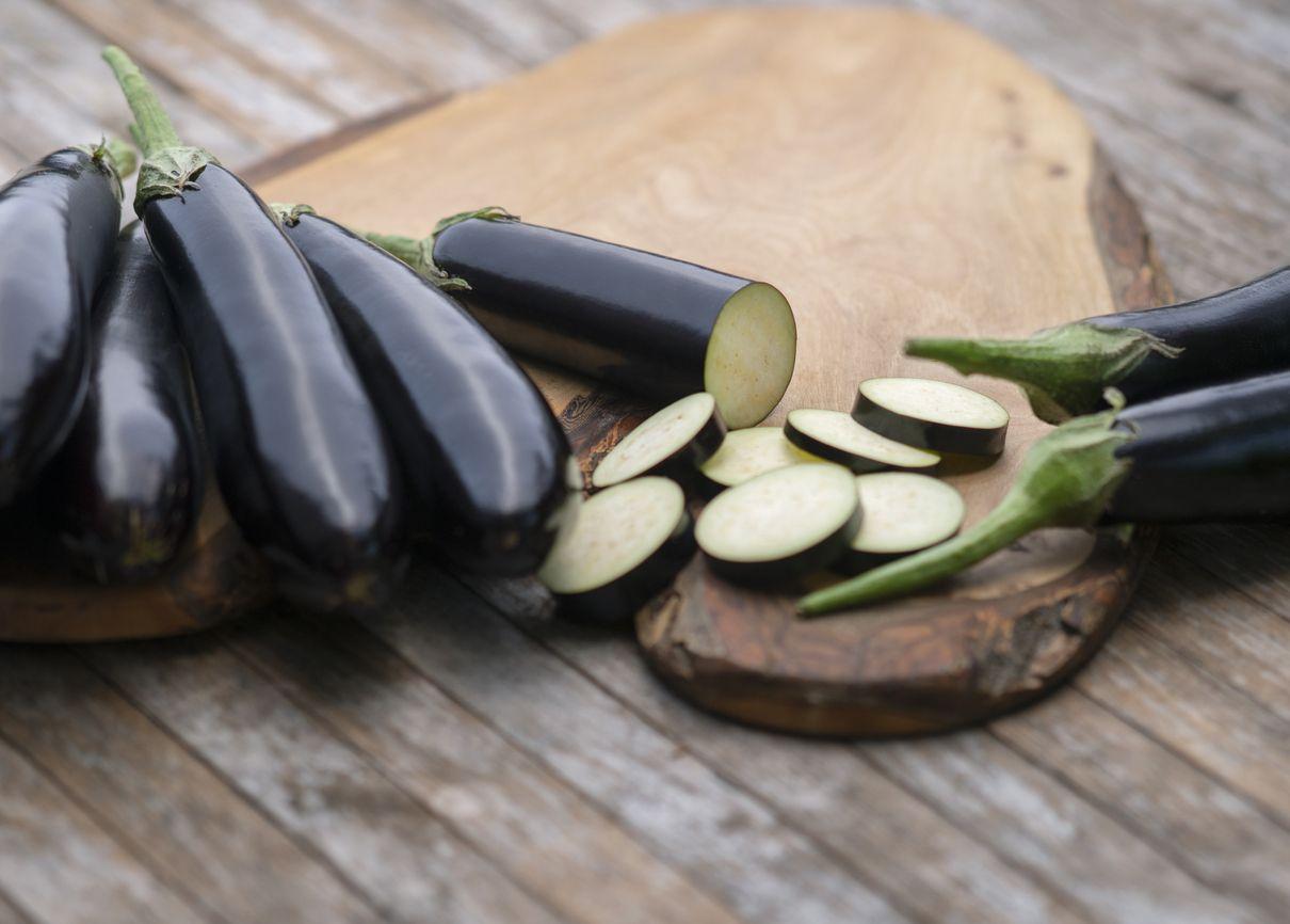 Organic eggplants on wood background