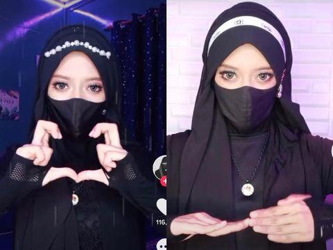 Wan Aishatun Wazifa Wan Ismail, viral di TikTok lewat aksinya goyang jari