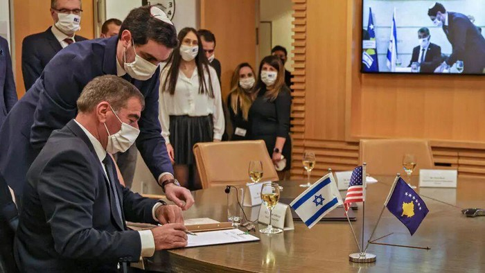 Israeli Foreign Minister Gabi Ashkenazi (L) signed a joint declaration establishing diplomatic ties with Kosovo during a ceremony held over Zoom with his counterpart from Kosovo, Meliza Haradinaj-Stublla, at Israels foreign ministry in Jerusalem menahem kahana AFP