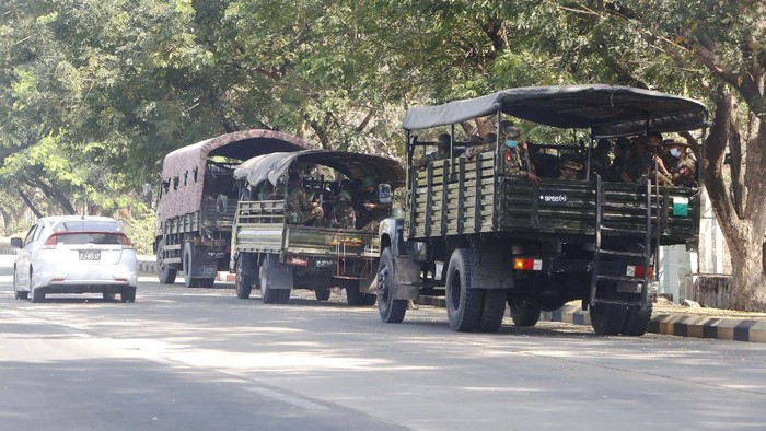Soldiers sit inside trucks parked on a road in Naypyitaw, Myanmar, Monday, Feb. 1, 2021. Myanmar military television said Monday that the military was taking control of the country for one year, while reports said many of the countrys senior politicians including Aung San Suu Kyi had been detained. (AP Photo)