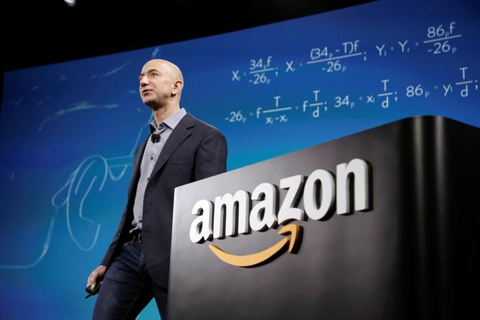 FILE PHOTO: Amazon CEO Jeff Bezos discusses his companys new Fire smartphone at a news conference in Seattle, Washington, U.S., June 18, 2014.   REUTERS/Jason Redmond/File Photo