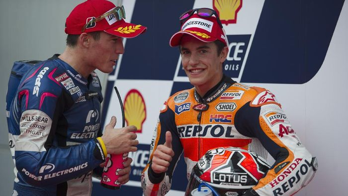 KUALA LUMPUR, MALAYSIA - OCTOBER 12:  Marc Marquez of Spain and Repsol Honda Team celebrates the pole position with Aleix Espargaro (L) of Spain and Power Electronics Aspar (CRT Pole Position) at the end of the MotoGP Of Malaysia - Qualifying at Sepang Circuit on October 12, 2013 in Kuala Lumpur, Malaysia.  (Photo by Mirco Lazzari gp/Getty Images)