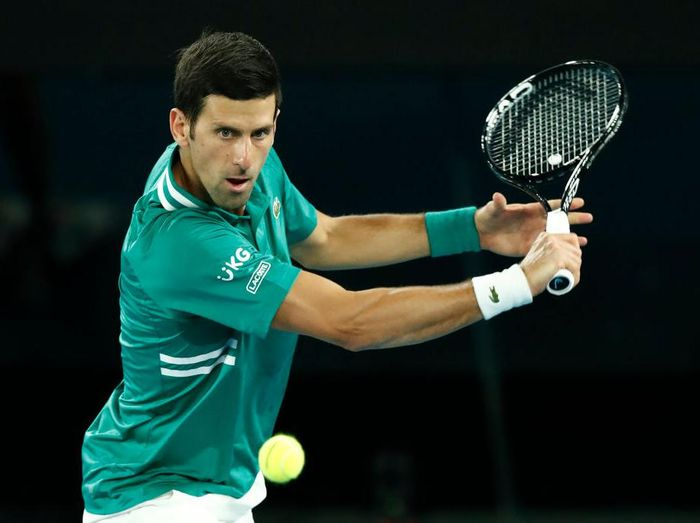MELBOURNE, AUSTRALIA - FEBRUARY 08: Novak Djokovic of Serbia plays a backhand in his Mens Singles first round match against Jeremy Chardy of France during day one of the 2021 Australian Open at Melbourne Park on February 08, 2021 in Melbourne, Australia. (Photo by Darrian Traynor/Getty Images)