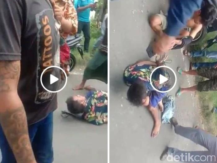 Beredar video dua jambret di Surabaya diikat dan dimassa. Dalam video tampak dua jambret tersebut babak belur.