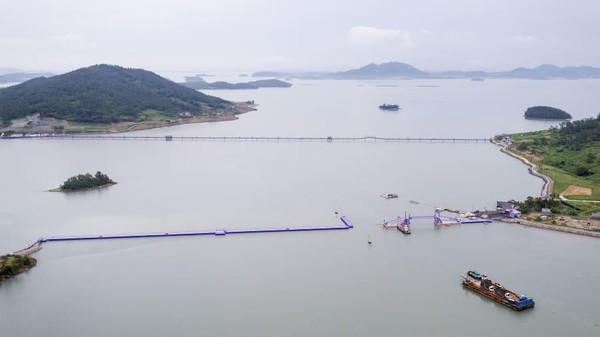 Proyek pulau ungu ini direncanakan pada tahun 2015. Tujuannya adalah untuk menciptakan desatinasi pulau yang menarik bagi wisatawan. (Shinan County Office)