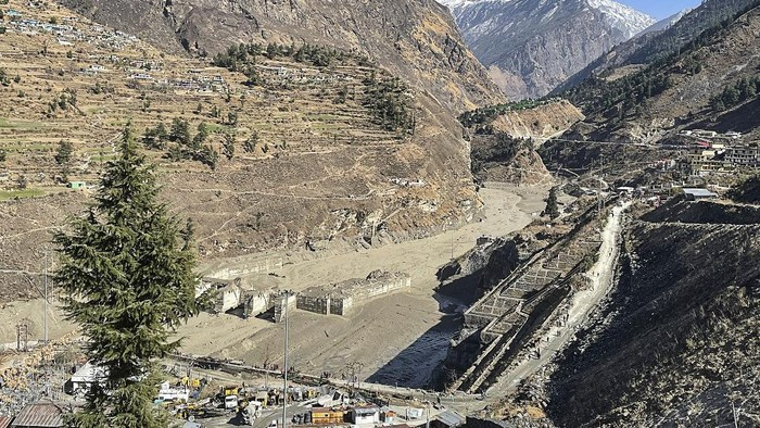 This general view shows state-run NTPC hydropower project site damaged after a broken glacier caused a major river surge that swept away bridges and roads, near Joshimath in Chamoli district of Uttarakhand, on February 7, 2021. - At least 200 people are missing in northern India after a piece of Himalayan glacier fell into a river, causing a torrent that buried two power plants and swept away roads and bridges, police said on February 7. (Photo by Ajay BHATT / AFP)