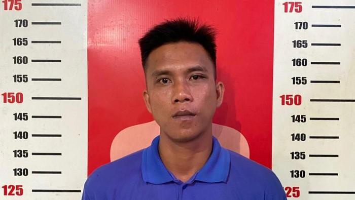 Iwan saat ditangkap polisi (dok. Istimewa)