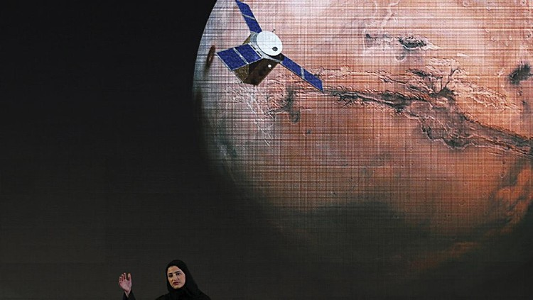 FILE - In this Wednesday, May 6, 2015 file photo, Sarah Amiri, deputy project manager of a planned United Arab Emirates Mars mission talks about the project named