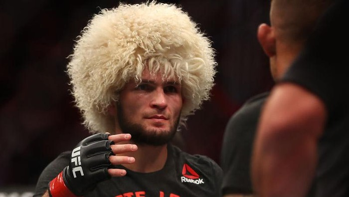 ABU DHABI, UNITED ARAB EMIRATES - SEPTEMBER 07: Khabib Nurmagomedov of Russia celebrates his submission victory over Dustin Poirier Dustin of United States in their Lightweight Title Bout during the UFC 242 event at The Arena on September 07, 2019 in Abu Dhabi, United Arab Emirates. (Photo by Francois Nel/Getty Images)