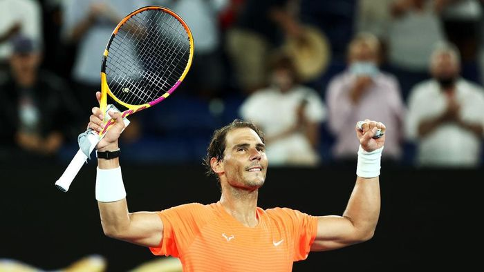 MELBOURNE, AUSTRALIA - FEBRUARY 11: Rafael Nadal of Spain celebrates winning his Mens Singles second round match against Michael Mmoh of the United States during day four of the 2021 Australian Open at Melbourne Park on February 11, 2021 in Melbourne, Australia. (Photo by Cameron Spencer/Getty Images)
